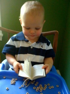 A budding Constitutionalist, Preston, reads mama's pocket sized version. Oh that he would be armed with the Word in one hand and the Constitution in the other.